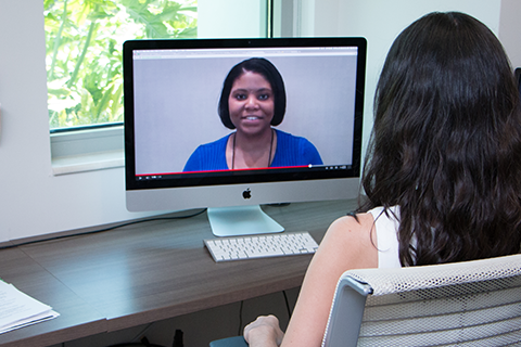 Student participates in a virtual career fair with recruiter.
